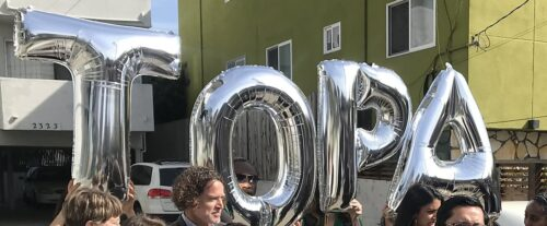 Silver baloons spelling out the letters TOPA
