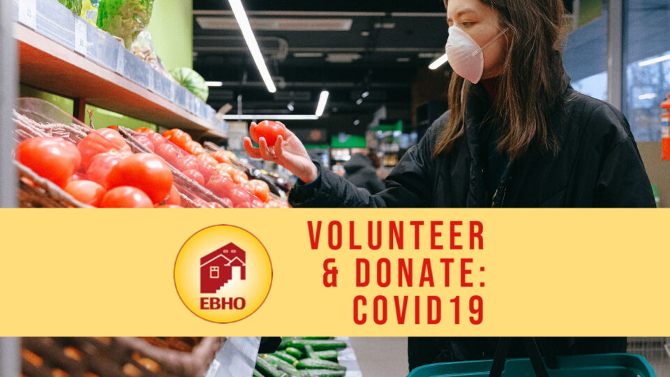 image of a woman wearing a mask holding up a tomato in a supermarket. A banner with the words volunteer & donate covid 19