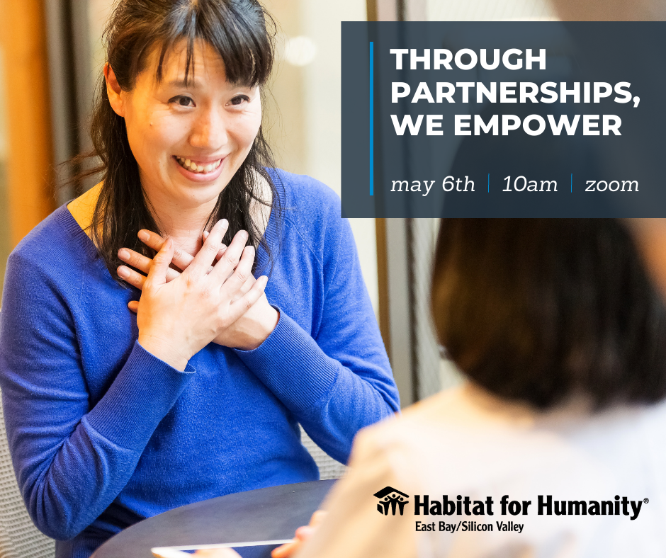 Habitat for Humanity person in blue shirt with hands on her chest, smiling warmly, talking to a person.