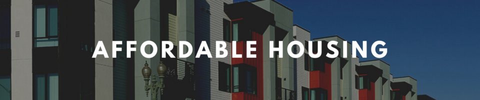 Image of part of a multi-family housing unit in multi-color blocks with the words Affordable Housing in white.