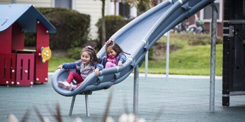 stock image children sliding