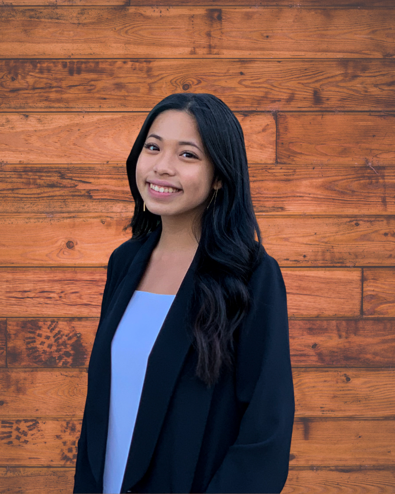 Megan Nguyen looks sideways at the camera, smiling.